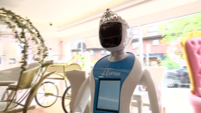 robotic waitress at the tea terrace in cobham; england: surrey: cobham: int various shots of robotic waitress 'theresa' working in the tea terrace... - tea cup stock videos & royalty-free footage