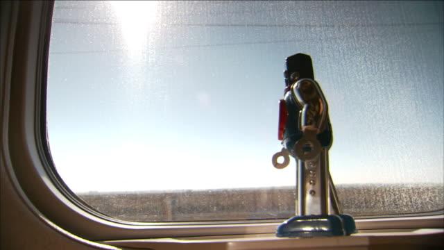 vídeos y material grabado en eventos de stock de a robotic wind up toy rides in the window of a train. - juguete