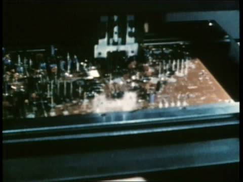Robotics assemble a circuit board to be used in the televisions on an assembly line