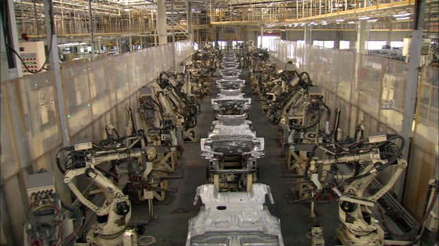 WS Robotics assembling cars on Beijing-Hyundai assembly line in factory / Beijing, China