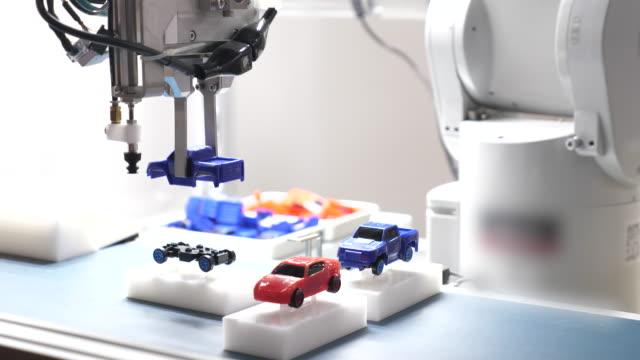 robotics - robotarm tillverkningsutrustning bildbanksvideor och videomaterial från bakom kulisserna