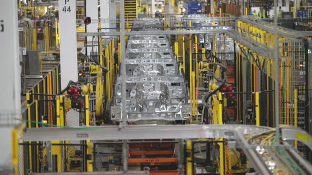 robots assemble ford vehicles at the chicago assembly plant on june 24 2019 in chicago illinois ford recently invested $1 billion to upgrade the... - ford motor company stock videos & royalty-free footage