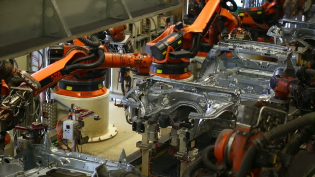 robots assembling car body - metal industry stock videos and b-roll footage