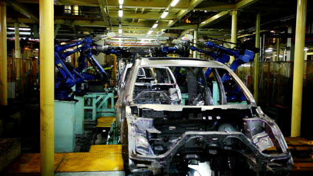 robots assembling car body - automobile industry stock videos & royalty-free footage
