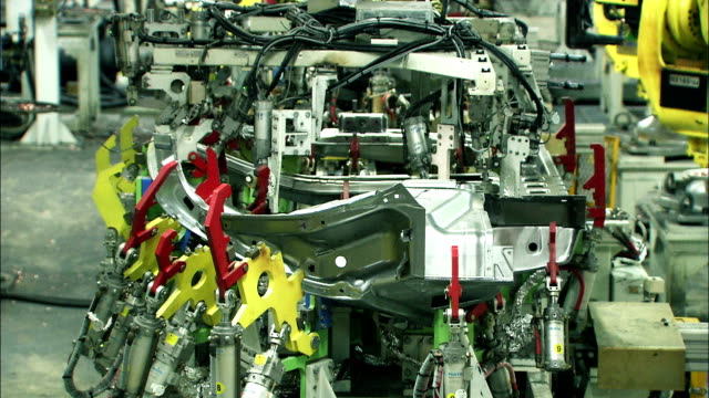 robots assembling car body - aluminum stock videos and b-roll footage