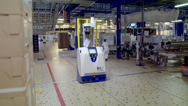 robots at work in a factory packing area - automated stock videos & royalty-free footage
