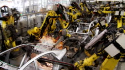 Robots collect and weld car bodies at the car factory