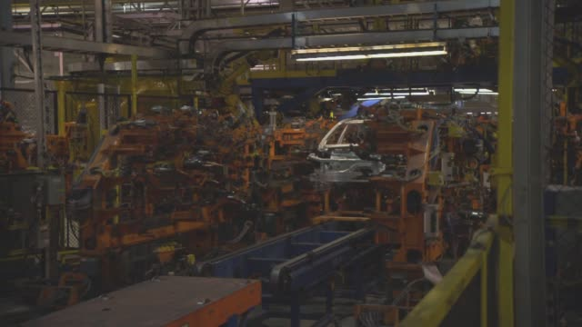 robots in slow motion at the general motors design center factory floor in warren michigan on november 20th 2013 various shot of sparks flying as... - general motors stock videos & royalty-free footage