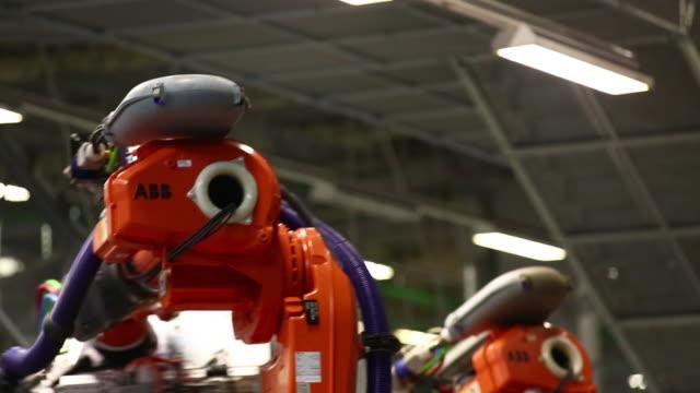 CU Robots moving a part of a car body