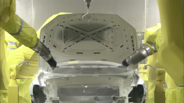 robots spray a newly manufactured auto body. - car plant stock videos & royalty-free footage