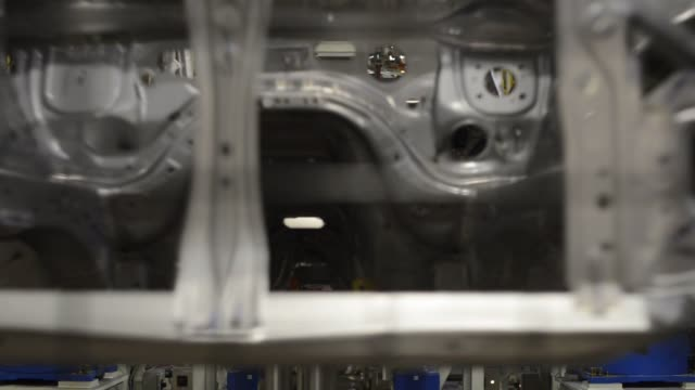 robots weld together stamped out metal parts at the subaru of indiana automotive inc assembly plant in lafayette, indiana, us, an employee works on... - subaru stock videos & royalty-free footage