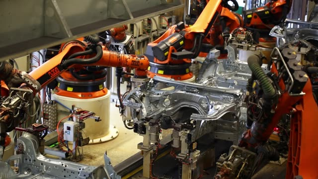 robots welding on car body - automated stock videos & royalty-free footage