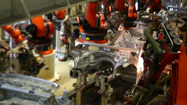 t/l robots welding on car body - car plant stock videos & royalty-free footage