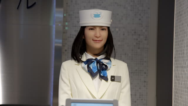 robots 'working' at a hotel reception, tokyo - robot stock videos & royalty-free footage