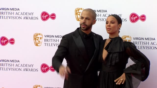 rochelle and marvn humes pose for photos on red carpet at bafta tv awards 2019 at royal festival hall london - british academy television awards stock videos & royalty-free footage