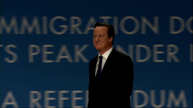 david cameron makes immigration pledge to voters lib birmingham conservative party conference cameron onto stage conservative cabinet members... - デビッド・キャメロン点の映像素材/bロール