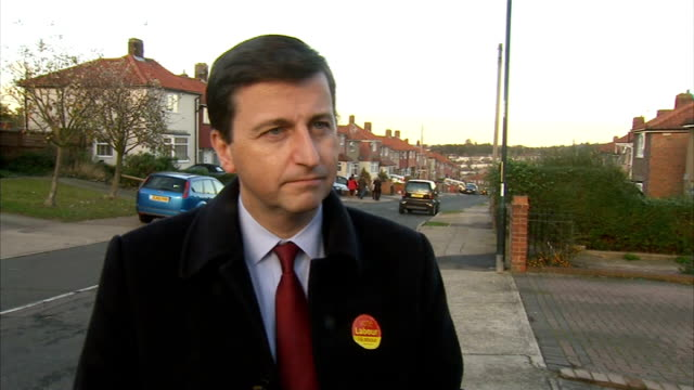 rochester by-election: douglas alexander and naushabah on campaign trail; england: kent: rochester: ext labour supporters along street / douglas... - douglas alexander stock videos & royalty-free footage