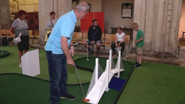 rochester cathedral installs minigolf course to attract new worshippers england rochester rochester cathedral int man playing minigolf various shots... - minigolf stock-videos und b-roll-filmmaterial