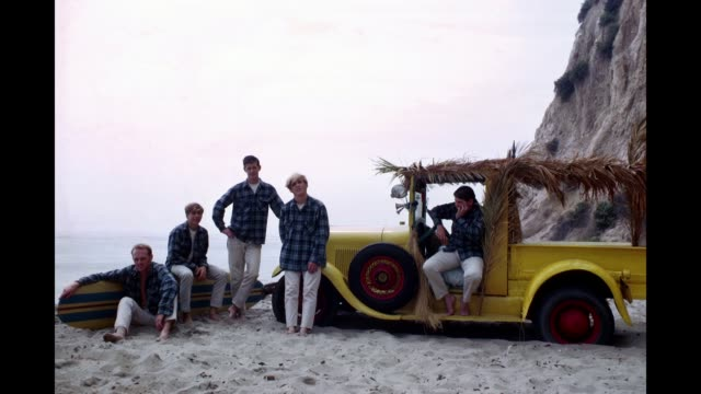 GIF Rock and roll band 'The Beach Boys' pose for a portrait with a vintage station wagon in August 1962 in Los Angeles California Mike Love David...