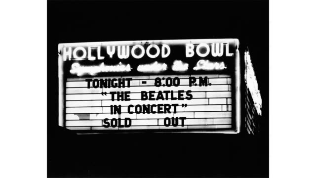 rock and roll band 'the beatles' perform at the hollywood bowl on august 23, 1964 in los angeles, california. - the beatles bildbanksvideor och videomaterial från bakom kulisserna