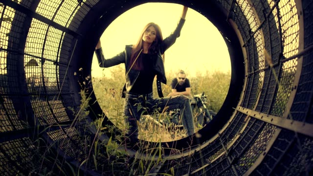 rock and roll couple. posing on a scrap-heap - model stock videos & royalty-free footage