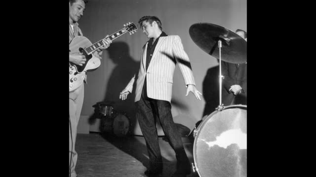 GIF Rock and roll musician Elvis Presley performing on the Milton Berle Show in Burbank California on June 4 1956