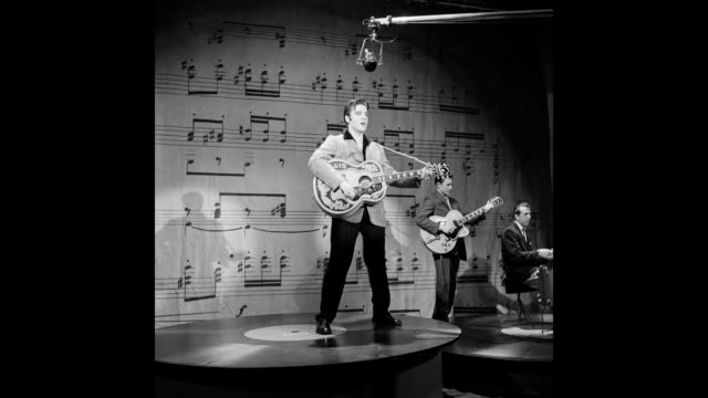 GIF Rock and roll musician Elvis Presley performs on stage on the Ed Sullivan Show in New York City NY on January 6 1957