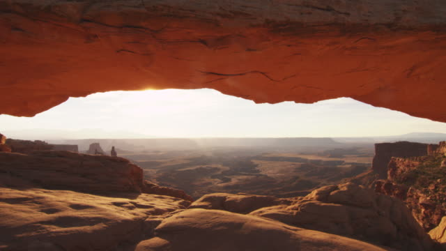 rock arch in scenic canyon landscape, dolly shot - moab utah stock videos & royalty-free footage