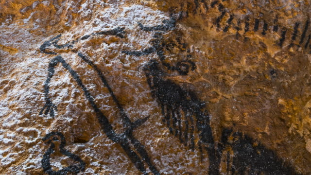 rock art in the lascaux cave at the international center for parietal art. lascaux iv at montignac in the vézère valley of the dordogne. perigord noir, nouvelle aquitaine, france, europe. unesco world - cave stock videos & royalty-free footage