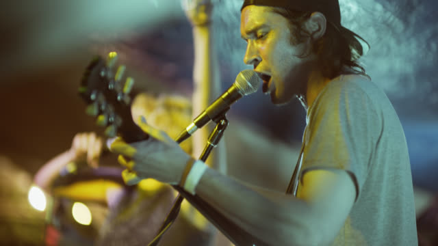 stockvideo's en b-roll-footage met rock band perform on stage at south by southwest music festival - zanger