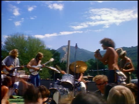 1968 rock band playing on stage at outdoor concert / tapia park ca / newsreel - klassischer rock and roll stock-videos und b-roll-filmmaterial