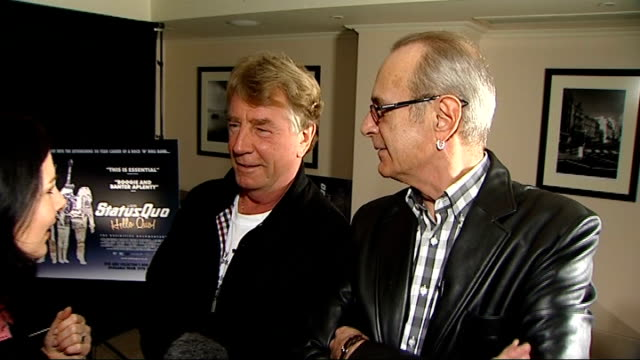 vidéos et rushes de rock band status quo launch documentary film 'hello quo' rick parfitt and francis rossi interview with reporter in shot sot on how band was formed - rock moderne