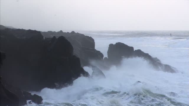 rock cliffs battered by surf - surf rock stock videos & royalty-free footage