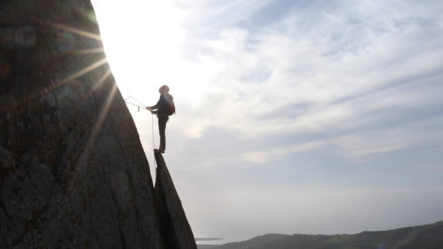 rock climber ascends above vertical rock flake - sports helmet stock videos & royalty-free footage