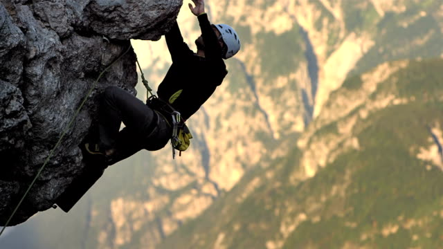 hd: rock climber chalking his hand - steep stock videos & royalty-free footage