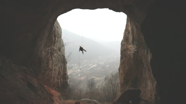 rock climber moving down - cave stock videos & royalty-free footage