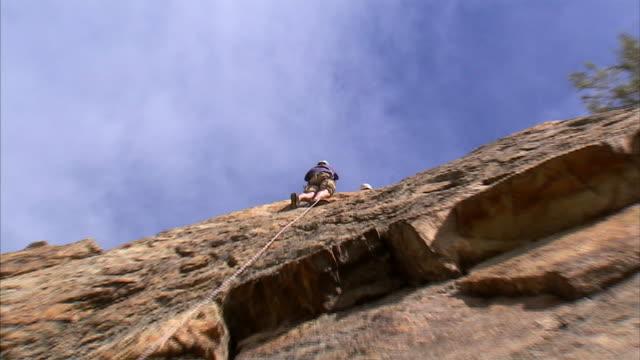 WS LA ZI Rock climber on cliff face / Provo, Utah, USA