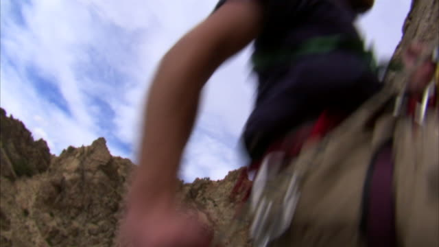 ms td rock climber repelling down cliff face / provo, utah, usa - rock face stock videos & royalty-free footage