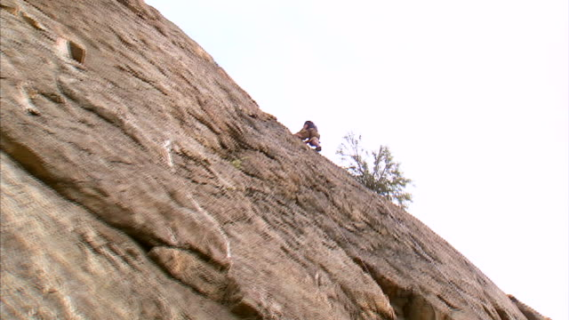 ws la zi rock climber repelling down cliff face / provo, utah, usa - rock face stock videos & royalty-free footage