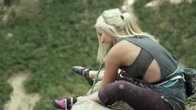 rock climber woman belaying from the top of the route. - belaying stock videos & royalty-free footage