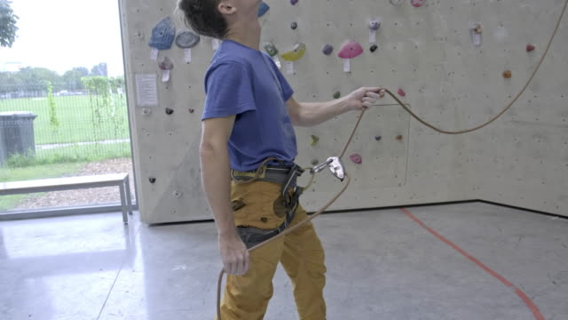 rock climber,close-up - safety harness stock videos & royalty-free footage