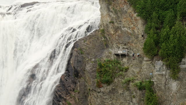rock climbers at montmorency falls , quebec, canada - spoonfilm stock-videos und b-roll-filmmaterial