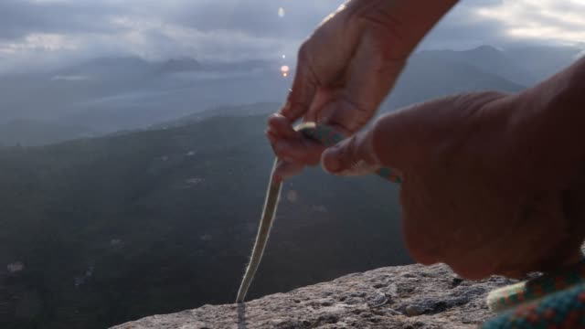 rock climbers hands let out rope for descent - only mature men stock videos & royalty-free footage