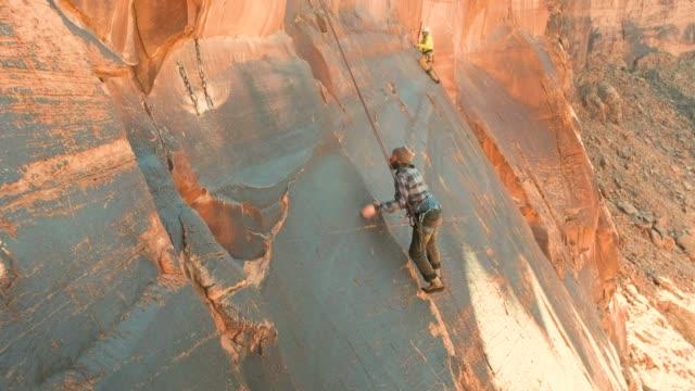 rock climbing in moab utah - climbing stock videos & royalty-free footage