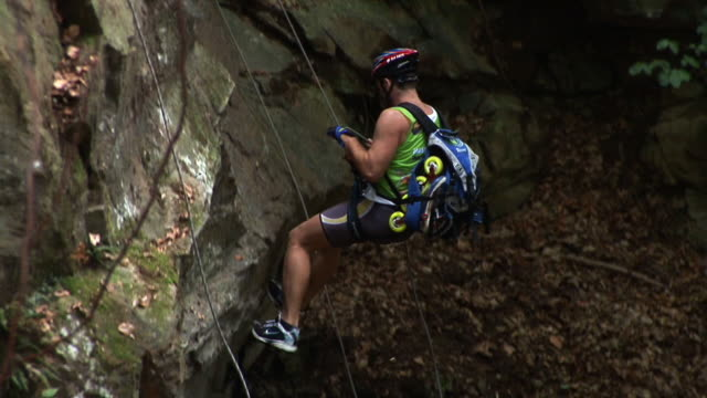 hd: rock climbing - abseiling stock videos & royalty-free footage
