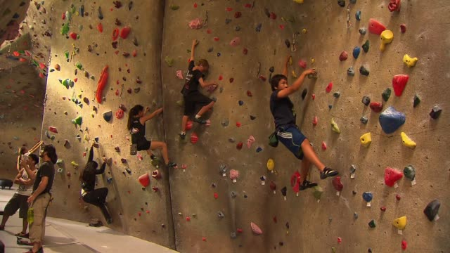 rock climbing wall - climbing wall stock videos & royalty-free footage
