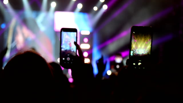 rock concert crowd during festival, hands and mobile phones - concert hall stock videos & royalty-free footage