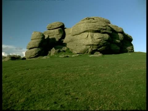 rock, dartmoor - ms granite tor rock formation on skyline - dartmoor stock videos & royalty-free footage