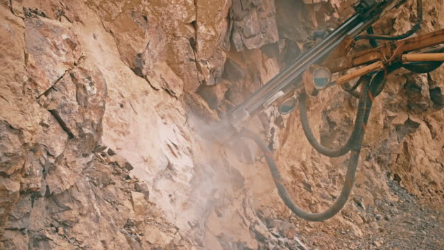 rock drilling machine - hydraulics stock videos and b-roll footage