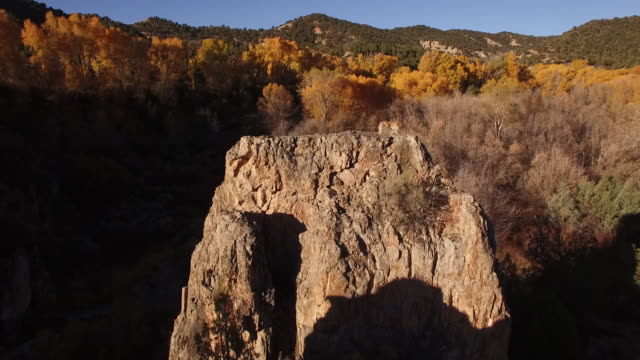 orbit rock face close,valley, foliage, fall colors, autum, travel, beautiful, forest, rock face, spire aerial, california, stock video sale - drone discoveries 4k nature/wildlife/weather drone aerial video - rock face stock videos & royalty-free footage